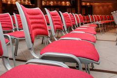 Empty red seats. A large concert hall full of emty red seats Stock Images