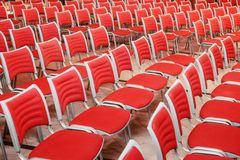 Empty red seats. A large concert hall full of emty red seats Royalty Free Stock Photos