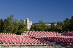Empty red seats. In an open space Royalty Free Stock Photography