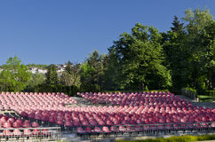 Empty red seats. In an open space Stock Photography