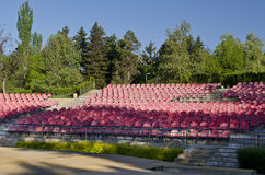 Empty red seats. In an open space Royalty Free Stock Image