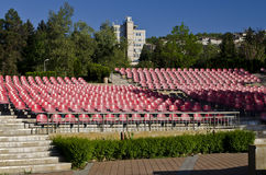 Empty red seats. In an open space Royalty Free Stock Photos