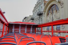 Empty red seats of red double decker tourist bus .No travellers and visitors for city tour in nasty cloudy day royalty free stock photos