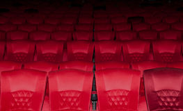 Empty red seats row in thearter. Background Empty red seats row in thearter Royalty Free Stock Photos