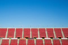 Empty red seats in  a spanish football stadium. With spanish and european flaggs Royalty Free Stock Photos