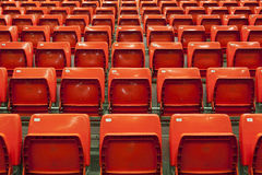 Empty red seats. Empty stadium red seats before a match Stock Photos