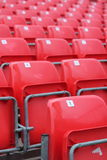 Empty red seats in stadium. With numbers Stock Images