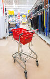 Empty red shopping cart Auchan store Stock Image