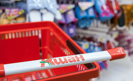 Empty red shopping cart Auchan store Stock Images