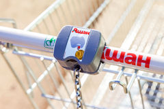 Empty red shopping cart Auchan store Royalty Free Stock Photo