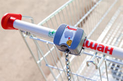Empty red shopping cart Auchan store Royalty Free Stock Image