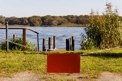 Empty Red Sign before Lake Copyspace Royalty Free Stock Photography