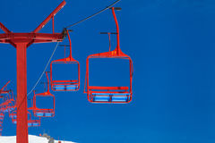 Empty red ski lift on the mountain Royalty Free Stock Image