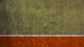 Empty red stripe on brown grunge wall. Brown dirty grunge wall with red stripe royalty free stock photo