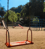 Empty red swing Royalty Free Stock Photo