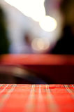 Empty red table and blur resturant background, street view Royalty Free Stock Photo