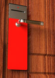 Empty Red tag on door handle Royalty Free Stock Photography