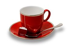 An Empty Red Teacup and Saucer With Teabag Isolate Stock Photos