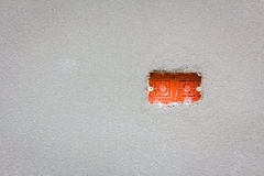Empty red wire box for power outlet installation with copyspace stock images