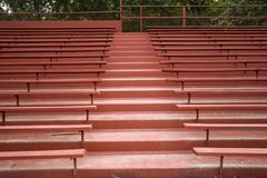 EMPTY RED WOODEN BLEACHERS royalty free stock images