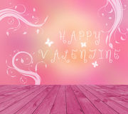Empty red wooden deck table with Happy Valentine text written on pink background with butterfly and branches.. Ready for product d Stock Image