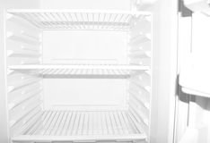 Empty refrigerator. Empty white student refrigerator without any food inside Stock Image