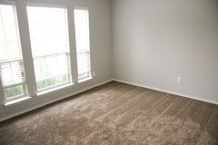 Empty Remodeled Bedroom with Carpet. Remodeled Bedroom with Carpet Stock Photography