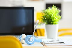 Empty remote office workplace with laptop and headset Stock Photos