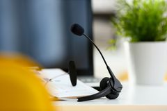 Free Empty Remote Office Workplace With Laptop And Headset Royalty Free Stock Images - 114790009