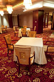 Empty restaurant. Interior of a restaurant with empty chairs and tables Royalty Free Stock Photo