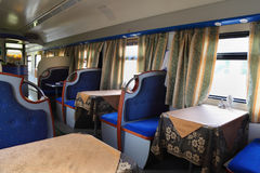 Empty restaurant with blue seats in train Stock Photography