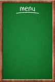 Empty restaurant menu. Green chalkboard and wooden frame Royalty Free Stock Photo