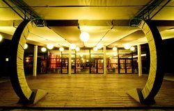 Empty restaurant at night. Empty restaurant terrace at night showing the warm glow of the lights.  Horizontal orientation Royalty Free Stock Photo