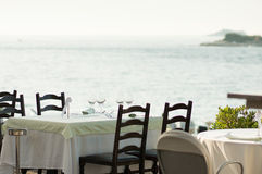 Empty restaurant table by the sea Stock Photography
