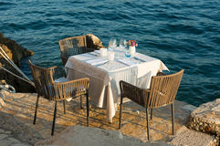 empty restaurant table setting by the sea Royalty Free Stock Photos