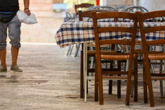 An empty restaurant table in the street. Of locorotondo, in the south of italy Stock Image