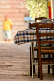 An empty restaurant table in the street. Of locorotondo, in the south of italy Stock Photos