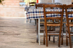 An empty restaurant table in the street. Of locorotondo, in the south of italy Royalty Free Stock Image
