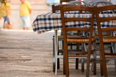 An empty restaurant table in the street. Of locorotondo, in the south of italy Royalty Free Stock Photo
