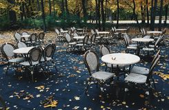 Empty restaurant tables and chairs stock image