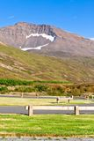 Empty resting area at Iceland roadside. With mountains as background stock image