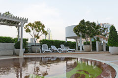 Empty resting chair near children swimming pool in hotel. Is business district Stock Images