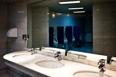 Empty restroom interior with washstands Royalty Free Stock Image