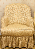 Empty retro brown armchair with floral pattern Royalty Free Stock Photography