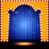 Empty retro stage with blue curtain Stock Photography