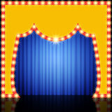 Empty retro stage with blue curtain Stock Images