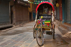 Empty rickshaw on street of Kathmandu, Nepal. Royalty Free Stock Photography