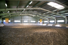 Empty riding hall with sandy covering Stock Images