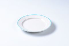 Empty rimmed dinner plate Royalty Free Stock Images