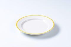 Empty rimmed dinner plate Stock Image